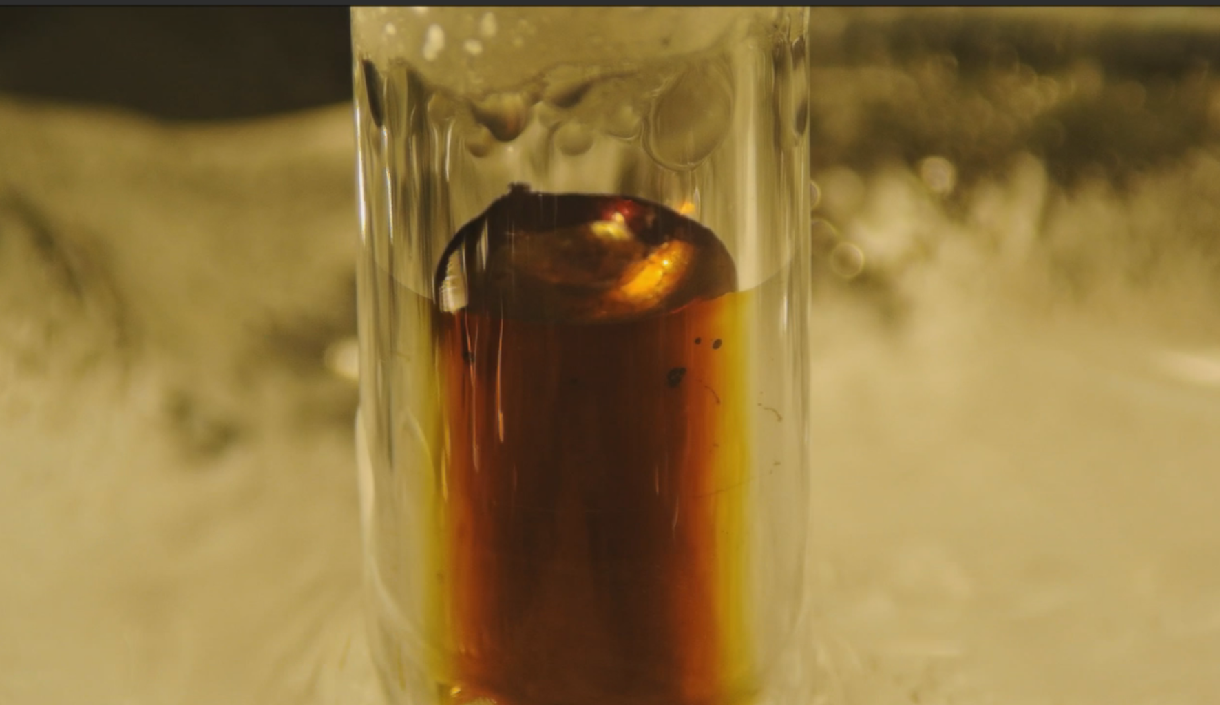 Gold colored metallic solution with higher concentration of excess electrons